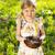 little girl holding an easter eggs in the nest stock photo © dashapetrenko
