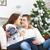 gelukkig · paar · vergadering · sofa · kerstboom · jonge - stockfoto © dashapetrenko