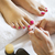 woman in nail salon receiving pedicure by beautician stock photo © dashapetrenko