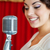 beautiful woman singing with the microphone stock photo © dashapetrenko