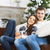 young couple sitting on the sofa by christmas tree stock photo © dashapetrenko