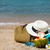 straw hat sunglasses beach towel with beach bag and coconut co stock photo © dashapetrenko