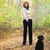 young woman walking with black labrador retriever puppy stock photo © dashapetrenko