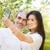happy couple making selfie photo on smartphone outdoors stock photo © dashapetrenko