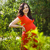 beautiful pregnant woman in red dress in the flowering spring pa stock photo © dashapetrenko