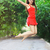 young happy woman wearing red dress jumping into a puddle stock photo © dashapetrenko