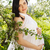 portrait of beautiful pregnant woman in white dress in the flowe stock photo © dashapetrenko