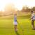 kids at a golf field holding golf clubs sunset stock photo © dashapetrenko