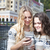 two happy women friends sharing social media in a smart phone ou stock photo © dashapetrenko