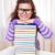 Little girl with pile of books stock photo © dashapetrenko