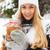 smiling woman holding cookies jar in her hands stock photo © dashapetrenko