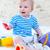 kicsi · fiú · játszik · tengerpart · játékok · színes - stock fotó © dashapetrenko