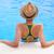 pretty brunette woman enjoying lemonade in a swimming pool stock photo © dashapetrenko
