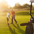 casual kids at a golf field holding golf clubs studing with trai stock photo © dashapetrenko