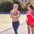runners on the stadium track women summer fitness workout stock photo © dashapetrenko