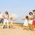 vidám · család · játszik · háború · tengerpart · nő - stock fotó © dashapetrenko