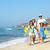 happy young family having fun running on beach at sunset family stock photo © dashapetrenko