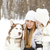 happy mother with daughter in the winter park with huskies dog stock photo © dashapetrenko