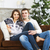 vergadering · sofa · kerstboom · jonge · gelukkig - stockfoto © dashapetrenko