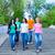 smiling group of teenagers walking outdoors stock photo © dashapetrenko