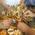 hands with white wine toasting over served table with food stock photo © dashapetrenko
