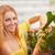 mulher · jovem · compra · flores · jardim · centro · cor - foto stock © dashapetrenko