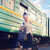 woman with a suitcase standing on the platform stock photo © dashapetrenko