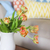 beautiful orange tulips bouquet on wooden table in the living ro stock photo © dashapetrenko