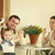 happy family with one year old baby girl drinking coffee indoor stock photo © dashapetrenko