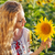 happy young woman with long hair in the sunflower field stock photo © dashapetrenko