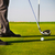 Male golfer putting, focus on golf ball stock photo © dashapetrenko