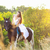 young woman riding a horse stock photo © dashapetrenko