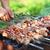 marinated shashlik lamb meat grilling on metal skewer close up stock photo © dashapetrenko