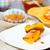 fresh baked pumpkin bread cut in slices on wooden board stock photo © dashapetrenko