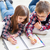 two little kids drawing with crayons stock photo © dashapetrenko