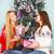 two pretty best friends girls opening christmas presents near th stock photo © dashapetrenko