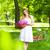 beautiful blond woman wearing a nice dress having fun in park wi stock photo © dashapetrenko