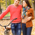 happy young couple with bicycle in autumn park stock photo © dashapetrenko