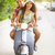 happy young couple riding a vintage scooter in the street wearin stock photo © dashapetrenko