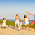 friends with children playing with frisbee on the beach stock photo © dashapetrenko