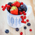 delicioso · frescos · frutas · blanco · azul · taza - foto stock © dashapetrenko