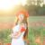 jonge · gelukkig · vrouw · poppy · veld - stockfoto © dashapetrenko