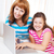 young woman with daughter using laptop computer stock photo © dashapetrenko