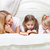 mother and her daughters reading bed time story book stock photo © dashapetrenko
