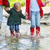 happy family wearing rain boots jumping into a mountain river stock photo © dashapetrenko