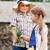 little boy gives flowers to the little girl stock photo © dashapetrenko