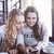 два · женщины · глядя · смартфон · улыбаясь - Сток-фото © dashapetrenko