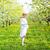 hermosa · mujer · embarazada · jardín · pie · árboles - foto stock © dashapetrenko