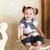 mosolyog · egyéves · kislány · bent · portré · baba - stock fotó © dashapetrenko