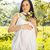 beautiful pregnant woman in white dress in the flowering spring stock photo © dashapetrenko